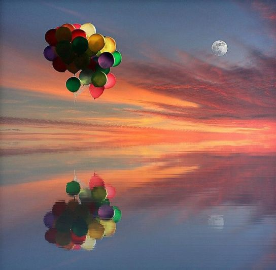 balloons reflected in tranquil water