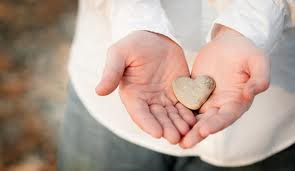 heart stone in hands