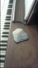 Stone on the piano